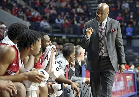 The Associated Press ON POINT: Arkansas men's basketball coach Mike Anderson talks to players Tuesday during the team's 75-64 road SEC win in The Pavilion at Ole Miss. Petre Thomas/The Oxford Eagle.
