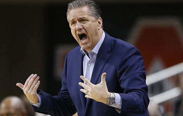 Kentucky head coach John Calipari reacts on the sidelines during the first half of an NCAA college basketball game on Wednesday, Feb. 14, 2018, in Auburn, Ala. (AP Photo/Brynn Anderson)