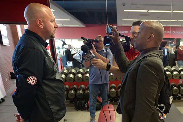 Arkansas assistant coach Jeff Traylor speaks Wednesday, Feb. 7, 2018, with members of the media in the Fred W. Smith Football Center on the university campus in Fayetteville.