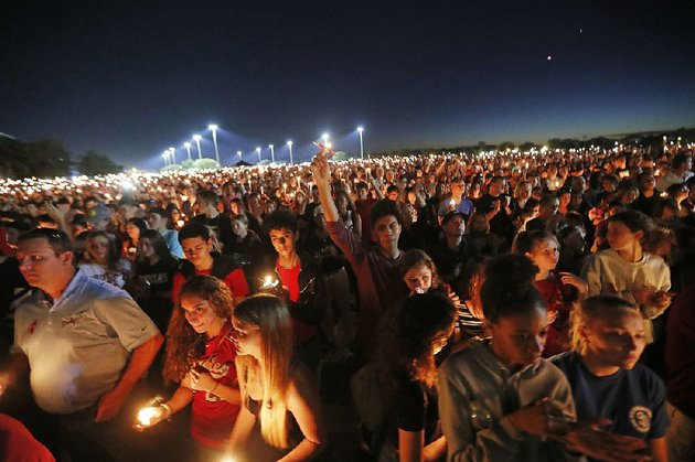 mourners-hold-a-candlelight-vigil-thursday-night-at-marjory-stoneman-douglas-high-school-in-parkland-fla