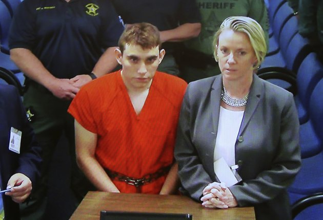 a-video-monitor-shows-school-shooting-suspect-nikolas-cruz-left-making-an-appearance-before-judge-kim-theresa-mollica-in-broward-county-court-thursday-feb-15-2018-in-fort-lauderdale-fla-cruz-is-accused-of-opening-fire-wednesday-at-the-school-killing-more-than-a-dozen-people-and-injuring-several-susan-stockersouth-florida-sun-sentinel-via-ap-pool