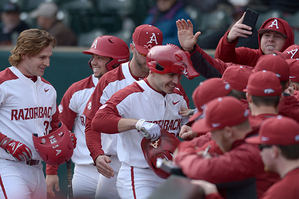 WholeHogSports - Starting with a blast: Hogs baseball team gets rolling early in opener