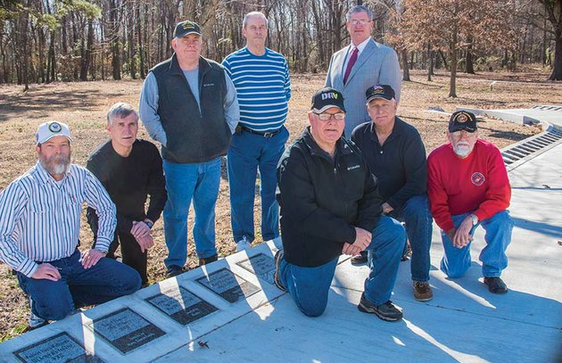 posing-with-some-of-the-tiles-installed-to-date-on-the-walk-of-honor-under-construction-at-the-veterans-memorial-park-in-russellville-are-front-row-from-left-jim-bob-jackson-bill-eaton-and-bill-hefley-and-back-row-ken-harper-president-of-the-river-valley-veterans-coalition-steve-hughes-russ-hall-richard-thomas-and-russellville-mayor-randy-horton-there-will-be-a-few-surprises-in-the-walk-of-honor-whenever-we-get-the-tiles-all-installed-harper-said-the-third-phase-of-the-park-is-expected-to-be-underway-in-march