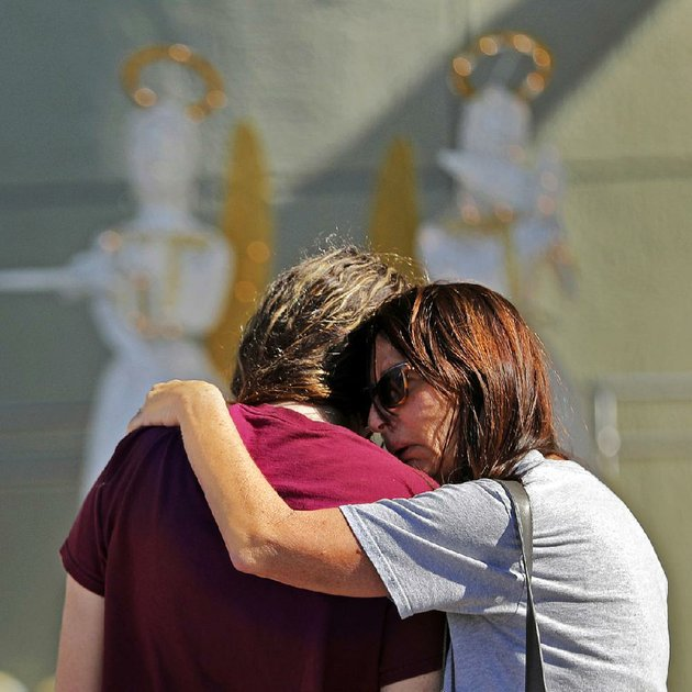 people-embrace-friday-at-a-memorial-for-the-victims-of-the-school-shooting-wednesday-in-parkland-fla-a-jan-5-tip-to-the-fbi-about-the-suspect-was-not-forwarded-to-the-miami-field-office-officials-said