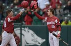 Arkansas second baseman Carson Shaddy (left) celebrates with third baseman Casey Martin after hitting a home run against Bucknell Saturday, Feb. 17, 2018, during the second inning at Baum Stadium in Fayetteville.