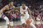 Daryl Macon of Arkansas drives to the lane as Admon Gilder of Texas A&M guards in the second half Saturday, Feb. 17, 2018, during the game at Bud Walton Arena in Fayetteville.