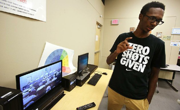senior-charles-robinson-talks-about-converting-vhs-tapes-of-the-north-little-rock-city-council-meetings-to-dvds-during-an-environmental-and-spatial-initiative-class-wednesday-at-north-little-rock-high-school