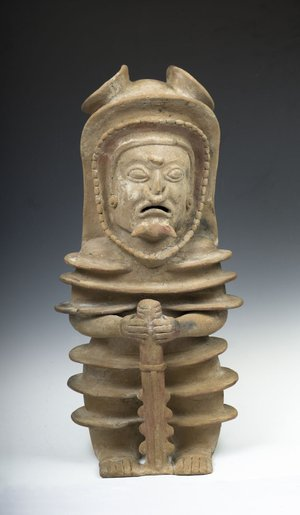 Courtesy Photo Jama-coaque warrior figure from Equador holds a macuahuitl (wooden club with obsidian blades inserted into it) in front. It dates in the 500 B.C. to 500 A.D. range. (1500-2500 years old) and measures 23 inches tall by 10 3/4 inches wide.
