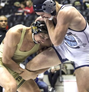 Bentonville High's Cash Jones (left) hooks the leg of Springdale Har-Ber's Britton Bowman on Saturday during the Class 6A-7A 170-pound championship match at the Jack Stephens Center at the University of Arkansas at Little Rock.