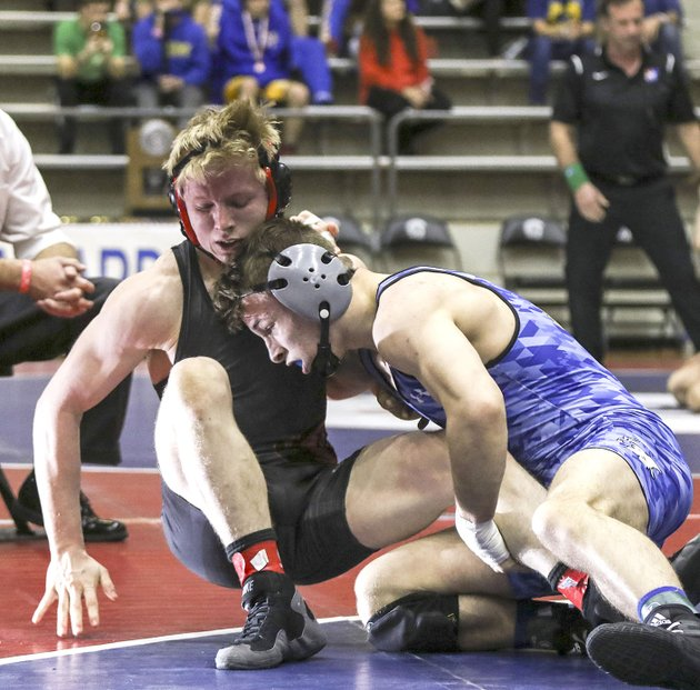 rogers-highs-jake-turner-right-brings-down-logan-sloss-of-russellville-on-saturday-in-the-class-6a-7a-145-pound-championship-match-at-the-jack-stephens-center-at-the-university-of-arkansas-at-little-rock