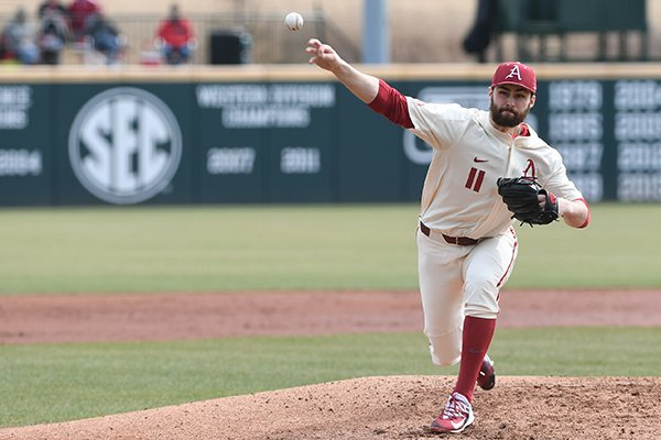 Arkansas pitcher Keaton McKinney throws during a game against Bucknell on Sunday, Feb. 18, 2018, in Fayetteville.