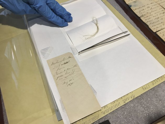in-this-feb-14-2018-photo-a-lock-of-george-washingtons-hair-and-the-envelope-that-contained-it-are-seen-on-a-table-in-the-union-college-library-in-schenectady-ny-john-myers-the-colleges-catalog-and-metadata-librarian-discovered-the-hair-strands-in-a-yellowed-envelope-hed-found-in-a-grimy-old-leather-bound-almanac-in-the-schools-archives-ap-photomary-esch