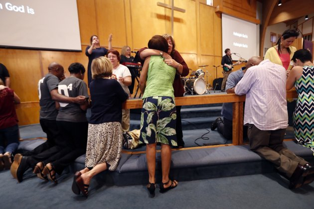 congregation-members-kneel-at-the-alter-during-a-service-at-the-first-united-methodist-church-in-coral-springs-fla-on-sunday-feb-18-2018-the-service-was-dedicated-to-the-victims-of-wednesdays-mass-shooting-at-nearby-marjory-stoneman-douglas-high-school-in-parkland-nikolas-cruz-a-former-student-was-charged-with-17-counts-of-murder-ap-photogerald-herbert