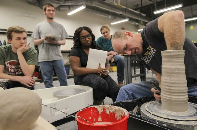 visiting-professor-fletcher-larkin-demonstrates-wheel-throwing-techniques-to-students-in-a-ceramics-class-at-the-university-of-arkansas-at-little-rocks-new-windgate-center-for-art-design