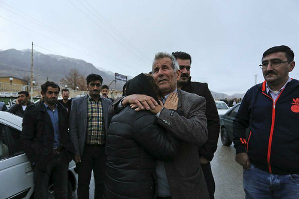Rescuers reach plane crash site in Iran mountains