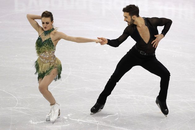 gabriella-papadakis-and-guillaume-cizeron-of-france-perform-during-the-ice-dance-short-dance-figure-skating-in-the-gangneung-ice-arena-at-the-2018-winter-olympics-in-gangneung-south-korea-monday-feb-19-2018-ap-photodavid-j-phillip