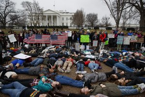 Trump backs efforts to bolster FBI gun checks; students protest outside White House