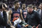 Auburn forward Anfernee McLemore (24) is carted off the court after an injury during the first half of the team's NCAA college basketball game against South Carolina on Saturday, Feb. 17, 2018, in Columbia, S.C. South Carolina defeated Auburn 84-75. (AP Photo/Sean Rayford)