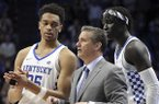 Kentucky's PJ Washington, coach John Calipari and Wenyen Gabriel, from left, watch as Shai Gilgeous-Alexander shoots free throws against Vanderbilt at the end of an NCAA college basketball game, Tuesday, Jan. 30, 2018, in Lexington, Ky. Kentucky won 83-81. (AP Photo/James Crisp)
