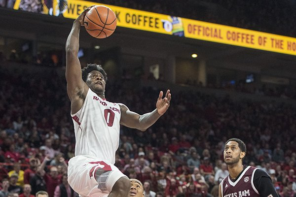 Jaylen Barford of Arkansas jumps for a dunk in the second half against Texas A&M Saturday, Feb. 17, 2018, during the game at Bud Walton Arena in Fayetteville.
