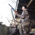 Colby Shastid (right), 15, stands ready to shoot as a group of ducks comes in for a landing during t...