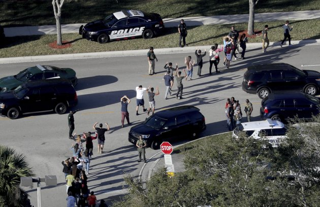file-in-a-wednesday-feb-14-2018-file-photo-students-hold-their-hands-in-the-air-as-they-are-evacuated-by-police-from-marjory-stoneman-douglas-high-school-in-parkland-fla-after-a-shooter-opened-fire-on-the-campus-frustration-is-mounting-in-the-medical-community-as-the-trump-administration-again-points-to-mental-illness-in-response-to-yet-another-mass-shooting-mike-stockersouth-florida-sun-sentinel-via-ap-file