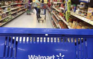 FILE- In this June 5, 2017, file photo, customers shop for food at Walmart in Salem, N.H. (AP Photo/Elise Amendola, File)