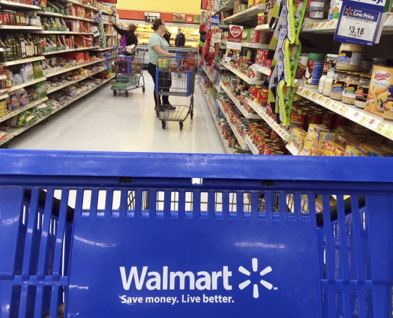File In This June   File Photo Customers Shop For Food At Walmart In Salem N H Ap Photo Elise Amendola File