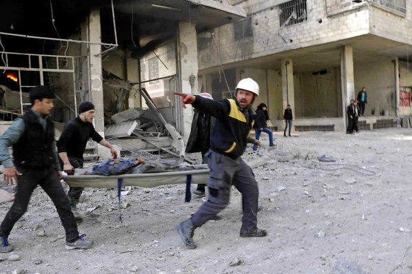 Nearly 100 killed in single day of strikes near Syrian capital