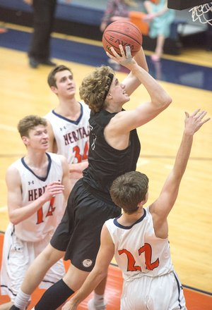 NWA Democrat-Gazette/BEN GOFF @NWABENGOFF Bentonville High's Asa Hutchinson (top) makes a shot over Rogers Heritage's Dawson Peek (22) on Tuesday at War Eagle Arena in Rogers.