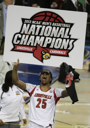 FILE - In this April 8, 2013, file photo, Louisville center Zach Price (25) holds signage after Louisville defeated Michigan 82-76 in the NCAA Final Four tournament college basketball championship game, in Atlanta. (AP Photo/Chris O'Meara, File)