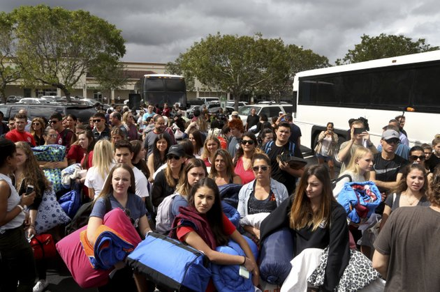 students-from-marjory-stoneman-douglas-high-school-get-ready-to-board-a-bus-for-a-trip-to-tallahassee-fla-to-talk-with-lawmakers-about-the-recent-rampage-at-their-school-in-parkland-fla-tuesday-feb-20-2018-mike-stockersouth-florida-sun-sentinel-via-ap