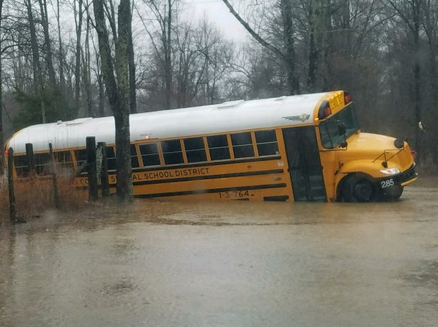 a-pulaski-county-school-bus-drove-off-a-flooded-road-and-got-stuck-wednesday-morning-authorities-said