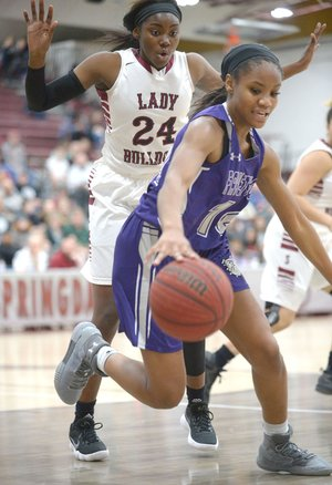 Fayetteville's Coriah Beck (right) tries to control a loose ball in front of Marquesha Davis of Springdale High on Tuesday at Bulldog Gymnasium in Springdale. Visit nwadg.com/photos for more photos from the games.