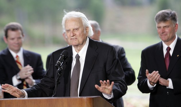file-in-this-may-31-2007-file-photo-billy-graham-speaks-as-his-son-franklin-graham-right-listens-during-a-dedication-ceremony-for-the-billy-graham-library-in-charlotte-nc-graham-who-transformed-american-religious-life-through-his-preaching-and-activism-becoming-a-counselor-to-presidents-and-the-most-widely-heard-christian-evangelist-in-history-has-died-spokesman-mark-demoss-says-graham-who-long-suffered-from-cancer-pneumonia-and-other-ailments-died-at-his-home-in-north-carolina-on-wednesday-feb-21-2018-he-was-99ap-photogerry-broome
