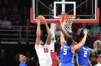 Arkansas' Daniel Gafford comes down with a rebound between Kentucky's P.J. Washington (left), Kevin Knox (5) and Jarred Vanderbilt (2) Tuesday Feb. 20, 2018 during the first half at Bud Walton Arena in Fayetteville.