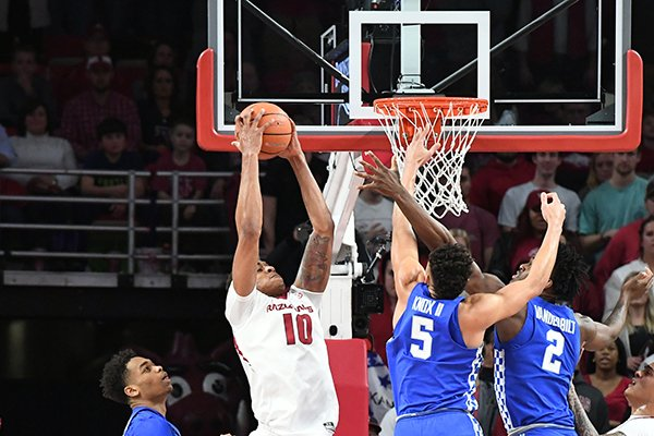 arkansas-daniel-gafford-comes-down-with-a-rebound-between-kentuckys-pj-washington-left-kevin-knox-5-and-jarred-vanderbilt-2-tuesday-feb-20-2018-during-the-first-half-at-bud-walton-arena-in-fayetteville