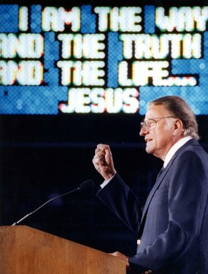 The Rev. Billy Graham speaks at a crusade at War Memorial Stadium in Little Rock in 1989. Graham, who died Wednesday at the age of 99, became a spiritual leader for millions at home and around the world.