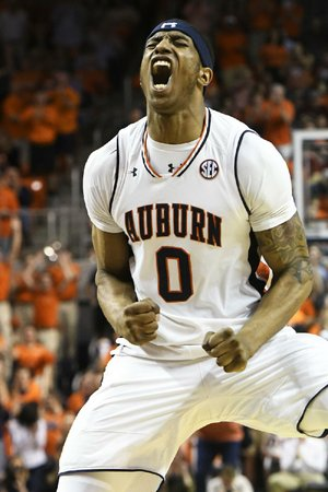 Auburn's Horace Spencer reacts after a three-pointer during the Tigers' victory over Alabama on Wednesday night.