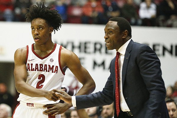 Alabama guard Collin Sexton shakes hands with Alabama head coach Avery Johnson during the second half of an NCAA college basketball game, Saturday, Dec. 30, 2017, in Tuscaloosa, Ala. (AP Photo/Brynn Anderson)