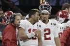 Alabama's Jalen Hurts (2) is seen on the bench with Tua Tagovailoa (13) head coach Nick Saban during the second half of the NCAA college football playoff championship game against Georgia Monday, Jan. 8, 2018, in Atlanta. (AP Photo/David J. Phillip)