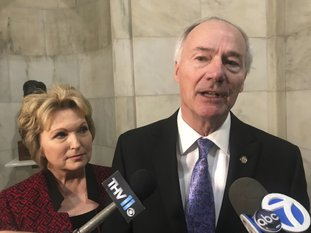 Arkansas Gov. Asa Hutchinson speaks to reporters at the state Capitol on Thursday in Little Rock after filing paperwork to run for re-election. Hutchinson made his bid for a second term official Thursday as he joined dozens of other candidates for state and federal office at the start of filing for this year's election. (AP Photo/Andrew Demillo)