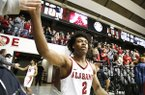 Alabama guard Collin Sexton (2) celebrates by giving high fives to fans after an NCAA college basketball game, Saturday, Dec. 30, 2017, in Tuscaloosa, Ala. (AP Photo/Brynn Anderson)