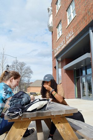 University of Central Arkansas students Samantha Pierce of Batesville, left, and Nena Igbokidi of Hot Springs sit at a table in front of UCA's Donaghey Hall. They are eating ice cream from Marble Slab Creamery. Four retail businesses at the location have closed since December, but UCA officials said the bottom spaces will be repurposed soon. Marble Slab will remain open.