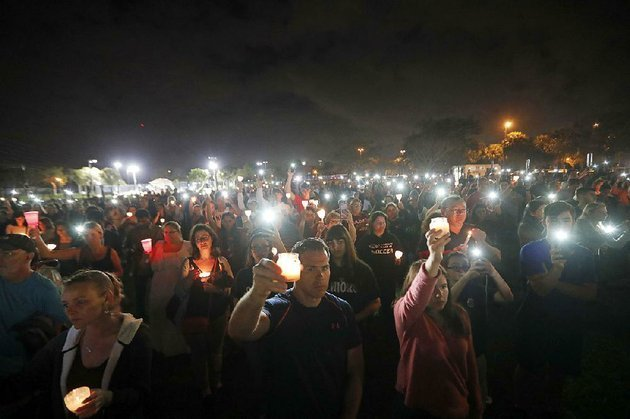 people-participate-in-a-candlelight-vigil-monday-in-memory-of-the-17-students-and-faculty-members-who-were-killed-in-the-feb-14-mass-shooting-at-marjory-stoneman-douglas-high-school-in-parkland-fla-nikolas-cruz-a-former-student-was-charged-with-17-counts-of-premeditated-murder-on-feb-15