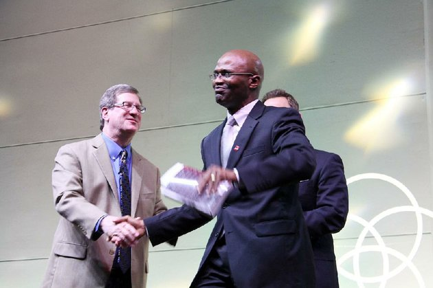 scott-mclean-center-shakes-hands-with-lee-strobel-left-as-he-accepts-a-signed-copy-of-strobels-the-case-for-christ-proceeds-from-the-ticket-sales-for-the-second-city-center-conversations-event-hosted-by-immanuel-baptist-church-in-little-rock-will-be-donated-to-the-prison-ministry-and-re-entry-program-pathway-to-freedom-which-mclean-heads