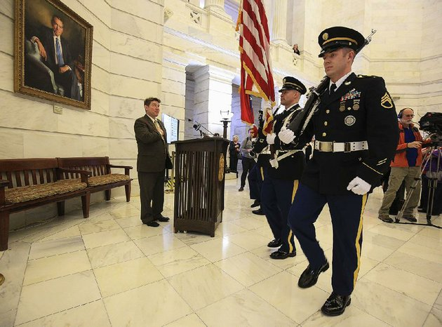 secretary-of-state-mark-martin-left-places-his-hand-over-his-heart-thursday-in-the-state-capitol-rotunda-as-an-arkansas-national-guard-honor-guard-presents-the-colors-before-martin-officially-declared-the-opening-of-the-candidate-filing-period
