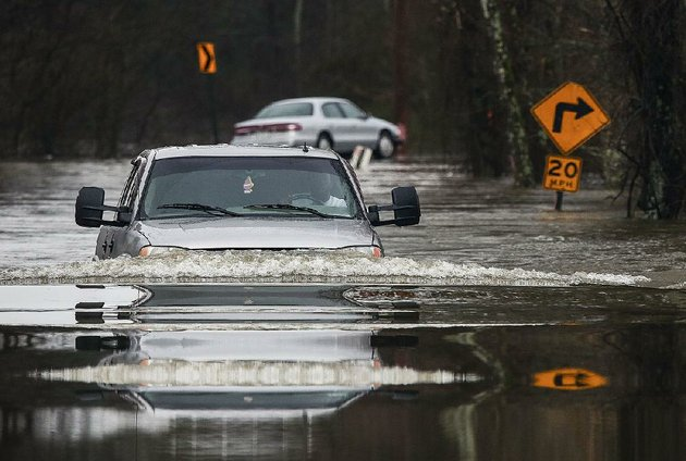 nick-jackson-of-north-little-rock-plows-through-high-water-friday-near-rixey-and-barnder-roads-in-north-little-rock-more-rain-is-forecast-today-for-much-of-arkansas