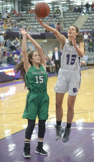 Sasha Gofoth (13) of Fayetteville scores over Irasema Sandoval (15) of Van Buren on Friday during the ÿrst half of play in Bulldog Arena in Fayetteville. Visit nwadg.com/photos to see more photographs from the games.