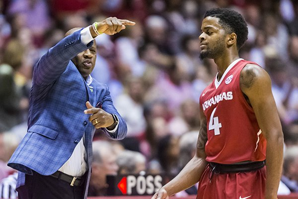 Arkansas coach Mike Anderson works with guard Daryl Macon (4) during the first half of the team's NCAA college basketball game against Alabama on Saturday, Feb. 24, 2018, in Tuscaloosa, Ala. (Vasha Hunt/AL.com via AP)